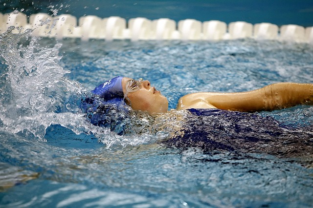 A child swims backstroke