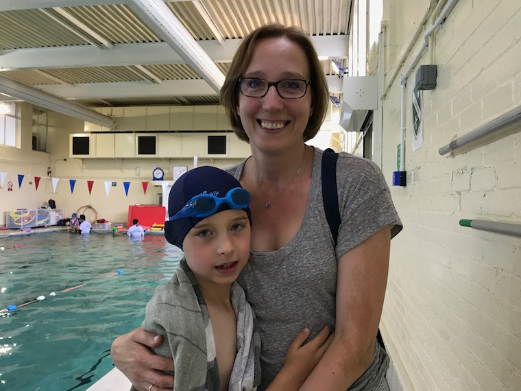 A-mum-and-his-son-after-a-swim-lesson-at-Blue-Wave-Swim-School