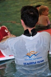 Swimming Instructor teaching swimming at Wimbledon college venue