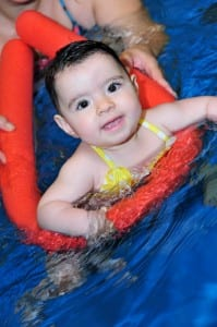 Baby swimming with a float at Blue Wave.