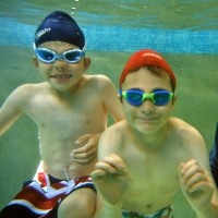 children learning swimming
