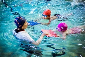 Blue Wave instructor teaches children using floats.