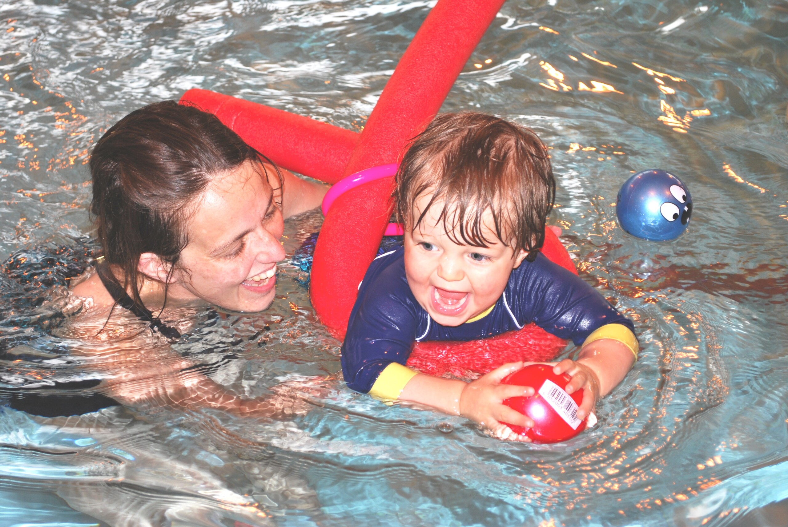 Parent and baby swimming class uses floats and toys at Blue Wave