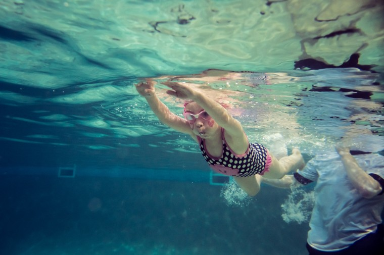 A child swimming independently in water