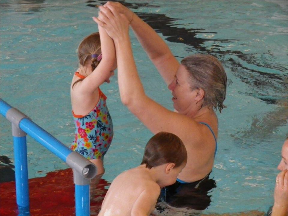 Lena Andersson Stenquist teaching toddler to swim