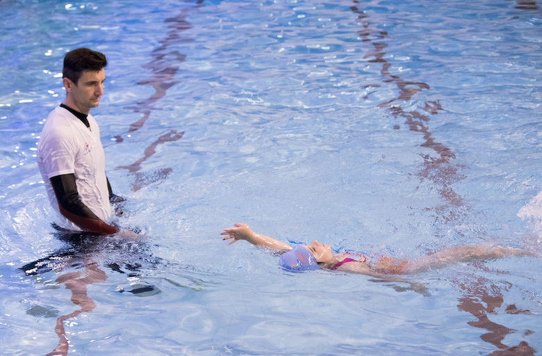 a 6 year old child swims backstroke with good technique