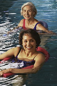 two adult at swimming lessons