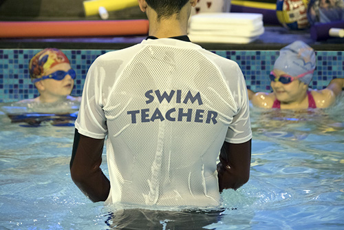 Swimming teacher at Blue Wave Swim School in London, U.K