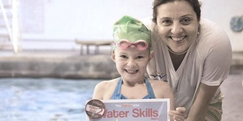 Marjan Moosavi, founder of Blue Wave Swim School with one of their swimmers who has received Swim England swimming badge and certificate