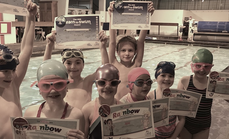 children at Blue Wave Swim school achieved 25 meter swimming badges and certificates