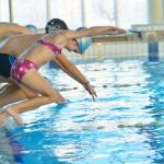 children diving in the swimming pool