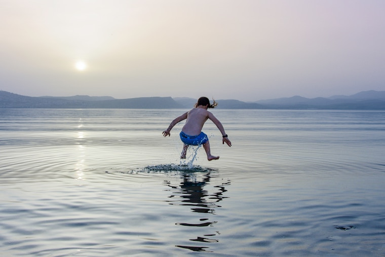a kid is swimming in open water