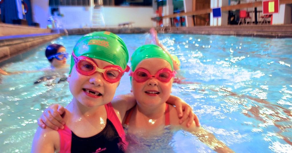 two children with swimming goggles at Blue Wave Swim school's swim lessons