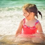 A child is happy in water in sea