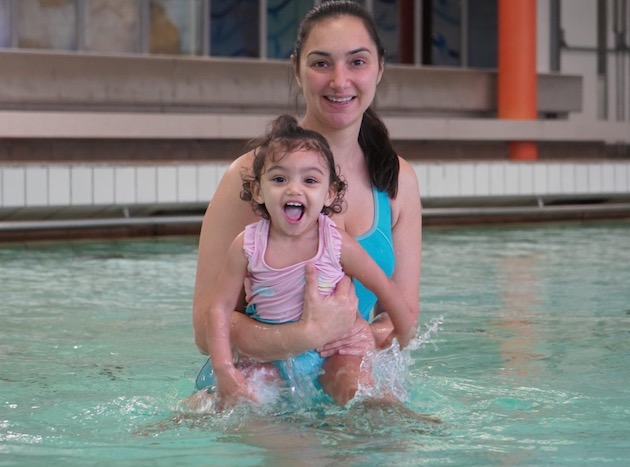 a toddler and her mum in swimming pool